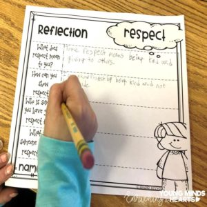 A picture of a student who is doing a written reflection about respect